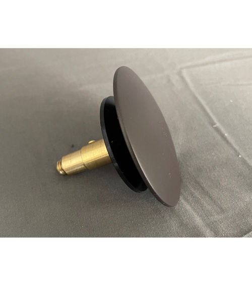 Replacement pop-up drain stopper for most freestanding tubs with integral overflows.